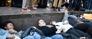 "NY Governor Andrew ""Hypocrite"" Cuomo participates in anti-gun die-in surrounded by armed security. Hundreds of useful idiots join in"